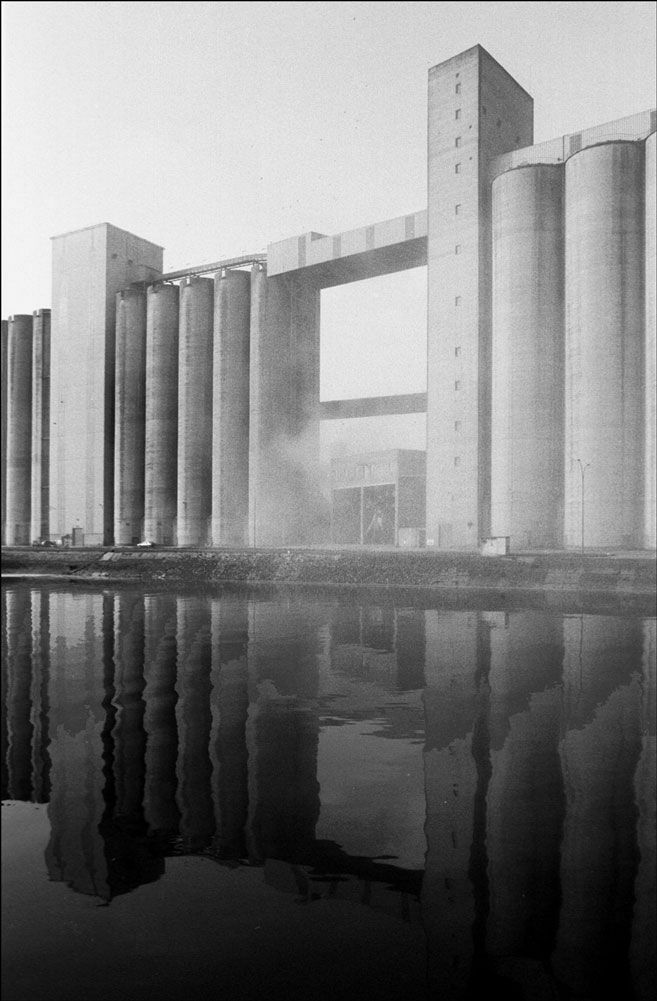 Industrial architecture also with a slight haze of smoke. The reflection along the water symbolizes the influence Mass Exodus will have on other's perceptions.