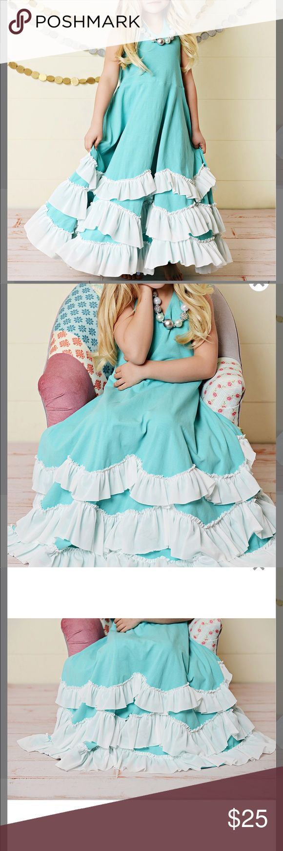 Oopsie Daisy mega twirl ruffle dress GREAT COND She will want to twirl for hours in this MEGA full dress!! This halter dress has a SUPER full skirt that is adorned with THREE rows of white frilly ruffles all the way around. This dress is sized as 9T. I'd say that best equates to a 7/8 size.  I do not see any flaws such add stations, Rips, etc.  My apologies for the wrinkles... I knocked my iron of the ironing board and broke it 😩 Ask questions, make offer or bundle for an instant discount…