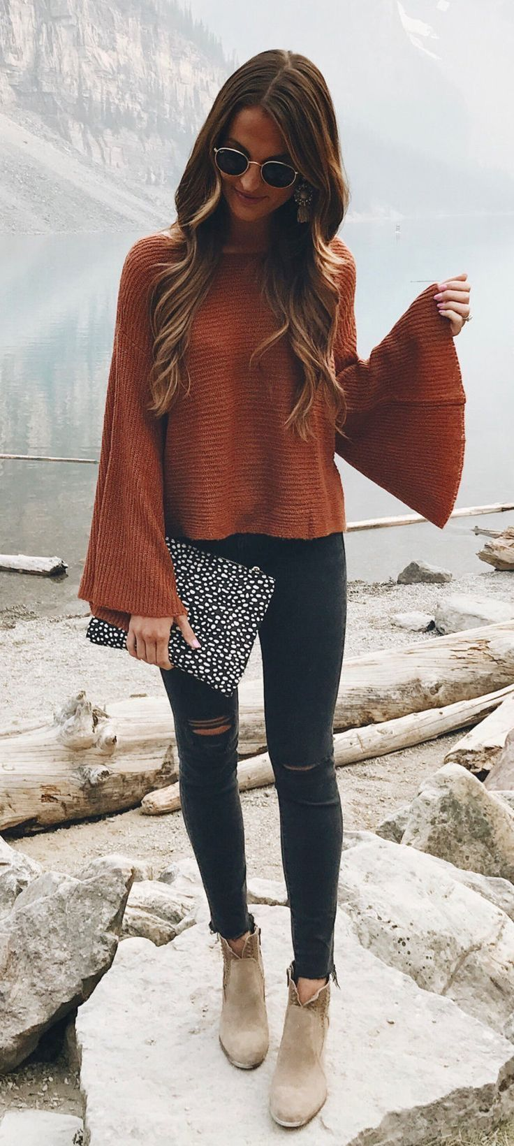 Cute burnt orange top with black jeans.