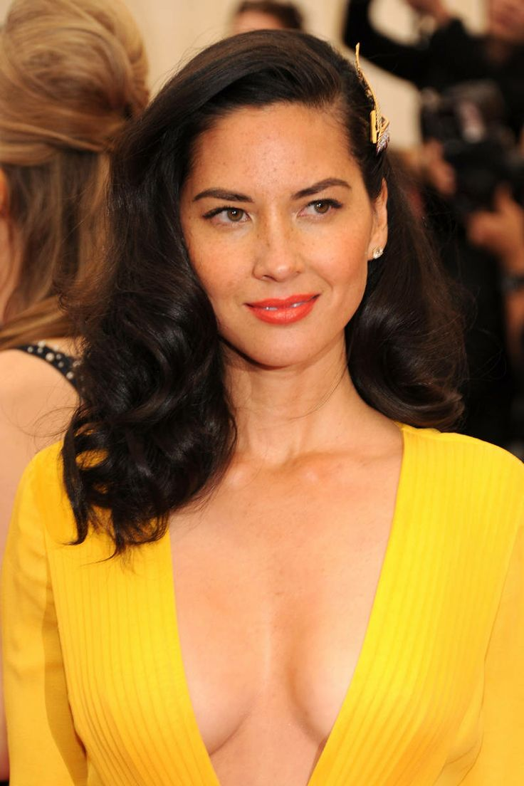 Olivia Munn: A punchy orange lip perfectly plays off Munn's bright dress and her gold hairpiece adds a sweet finishing touch.