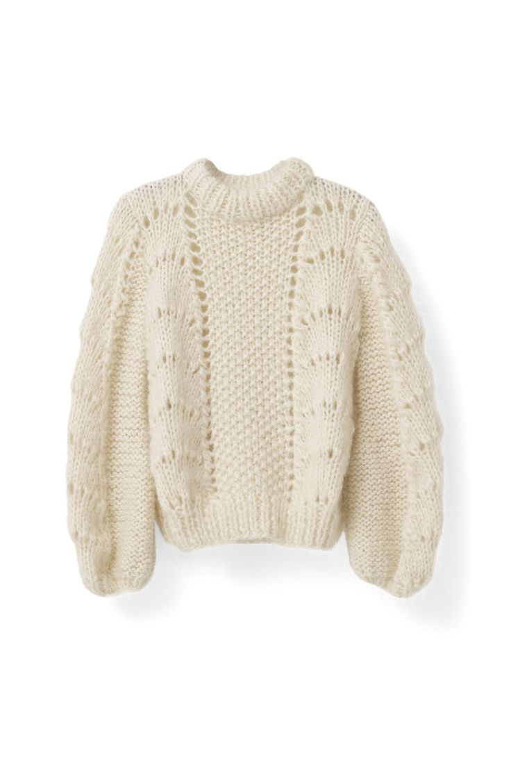 Exclusive Italian hand-knitted pullover knitted  by local Italian women from the South of Tuscany  in Italy. The production is run by a family-owned  business. It takes each woman three days to knit  one sweater, and due to the hand-knitting process  all pieces are unique. The pullover features a  voluminous scallop and pearl pattern with bell  sleeves and an oversize fit.