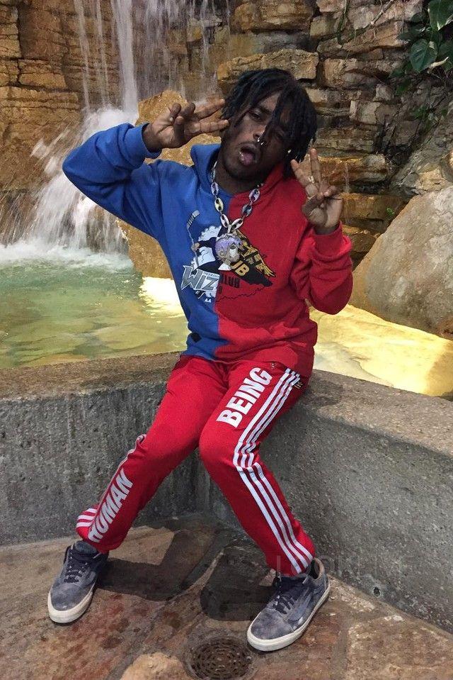 Lil Uzi Vert wearing  Off-White c/o Virgil Abloh Midnight Studios Reassembled Hoody, Vans Suede Woven Old Skool Sneakers, Adidas Pharrell Williams Human Being Sweatpants
