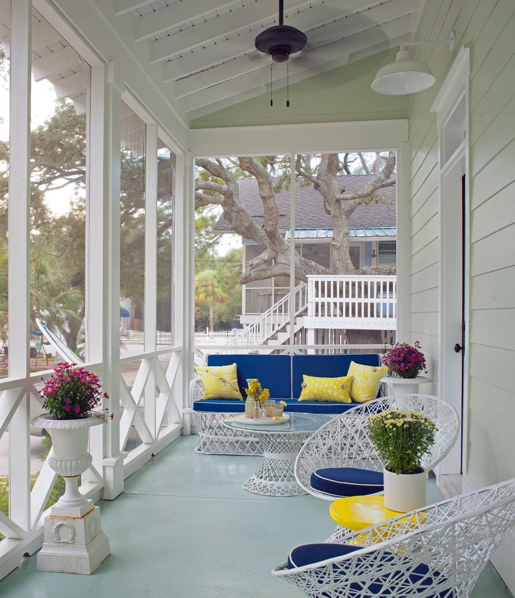 Leave it to Rethink Design's Joel Snayd to make a screened-in bungalow look so alluring. With French-wire furniture and hues like cobalt blue and yellow accents, this fanciful space appeals to your girly side without scaring away the guys.    - GoodHousekeeping.com