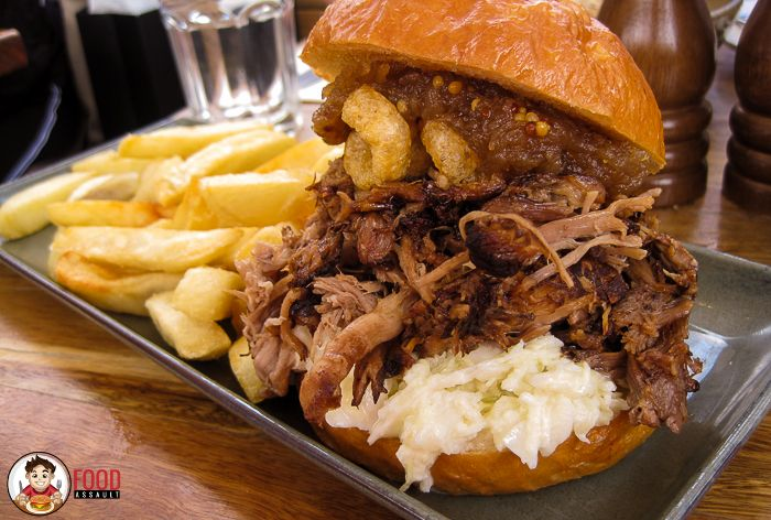 Slow cooked Pulled Pork Sandwich with Apple Dijon Relish and Pork Crackling at The Butcher's Block.