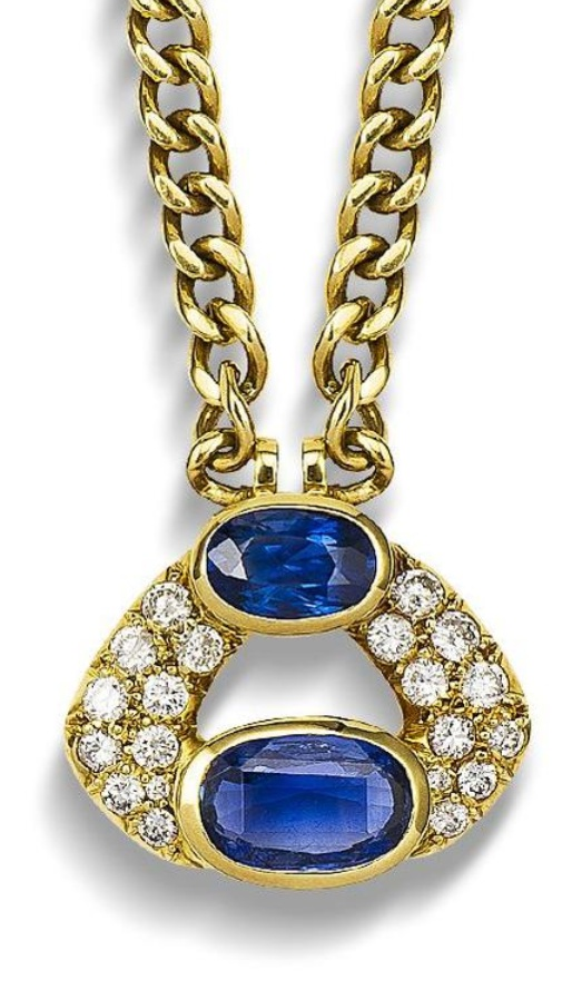A sapphire and diamond pendant necklace  The two oval mixed-cut sapphires connected by two courses of brilliant-cut diamonds, suspended from a flattened curb-link chain, diamonds approximately 1.35 carats total, pendant length 2.3cm, chain length 40.6cm