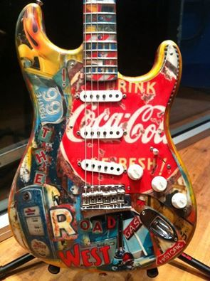 """'Guitar Art - The Road West Edition Now HERE's some really amazing playable art! Check out """"The Road West"""" a Greg Fessler Masterbuilt Fender Stratocaster, featuring lots of cool Americana, including Route 66 and Coca-Cola! What do YOU think? REALLY COOL or NOT REALLY?'"""