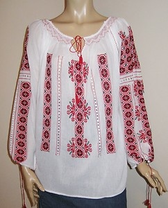 Red and black Romanian hand embroidery on a traditional Romanian blouse