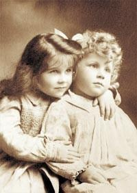 Lady Elizabeth Bowes-Lyon (The Queen Mother) with her younger brother, David, circa 1903.