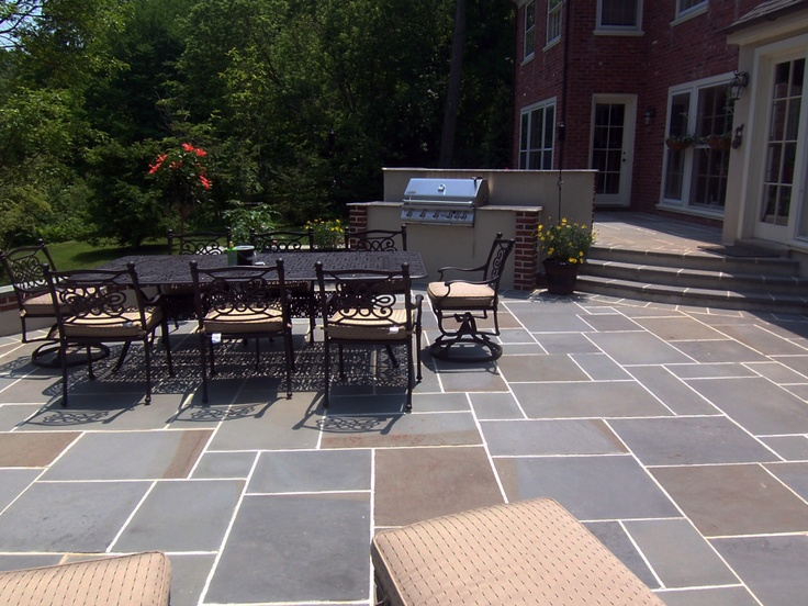 Blue Flagstone Patio With Brick Corner Accented Stucco