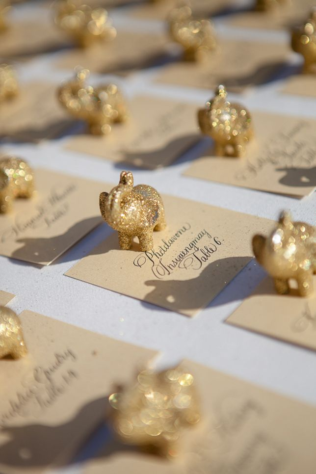 { . } Gold elephant escort cards