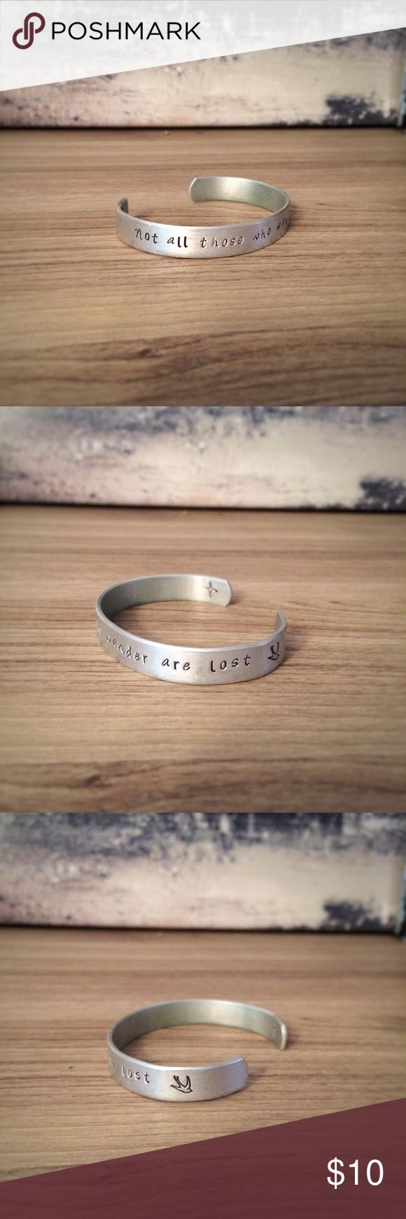 Hand Stamped bracelet with bird stamp and compass Lord of the Rings - The fellowship of the Ring - Not all those who wander are lost Hand Stamped bracelet with bird stamp and compass  Cuff is 6 inches long and 3/8 wide  The cuff is a bright silver tone and made of Pure High Grade Aluminum 1100, which is safe on your skin. There is a much lower rate of skin reaction with PURE ALUMINUM than with sterling silver. It is lightweight, but very sturdy and is sure to become your new favorite…