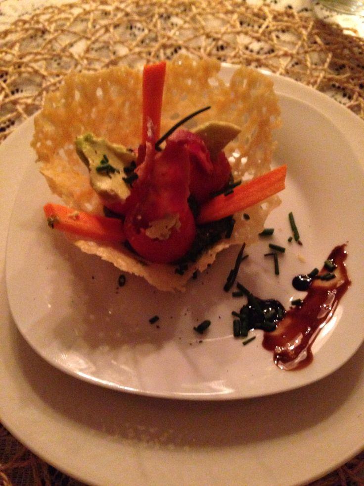 Parmesan bowl, cilantro pesto cream, cherry tomatoes, avocado, bacon, green onion, carrot.