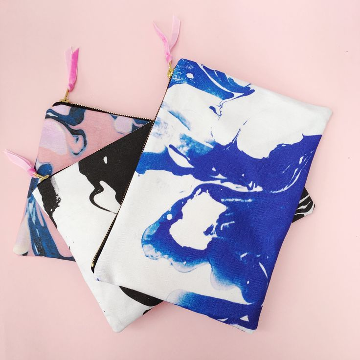 These beautiful marbled fabric pouches are guaranteed to make you smile. The design is taken from one of Pup Tart's hand marbled papers and digitaly  printed creating a fun and contemporary design. Each pouch is stitched in   our London studio. Available in 3 swirly patterned colours.