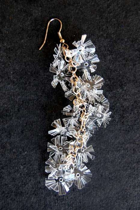 Recycled plastic water containers. Snowflake earring by Kumvana Gomani.