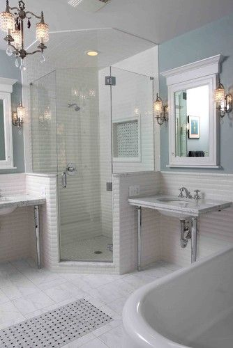 "Shower stall:  ""Pony walls around a corner shower stall enclose sink areas and provide a backsplash. Using clear glass to enclose the stall keeps a more open feeling and makes the space feel larger."""