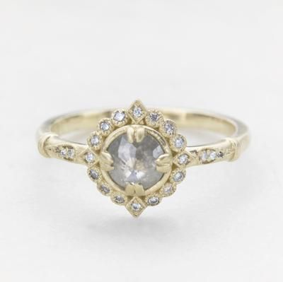 Vintage grey rose cut diamond halo ring that we call our Frederica ring. The center stone is uniquely set with double prongs aligned in a North/South/East and West orientation. A never-ending circle of diamonds and milgrain edges makes this ring delicate & full of antique romantic details. Shown with a grey rose cut diamond. // roughluxejewelry.com