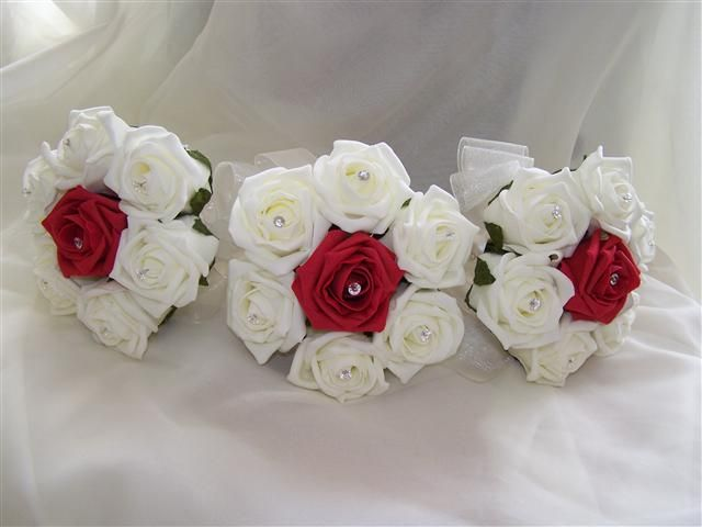 white roses with red center bouquet. have red roses with a white center bouquet for the bride to set her apart :)