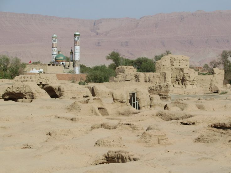 A two-story tower still stands in the ruins of the 7th century city of Gaochang southeast of Turpan, Xinjiang, China. The Flaming Mountains provide a backdrop.