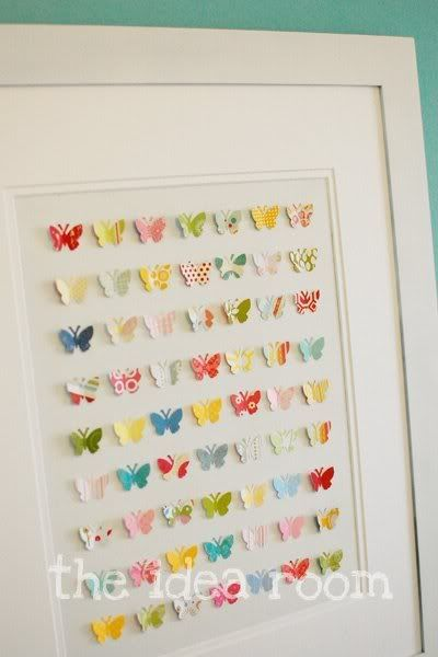scraps of pretty paper, punched with a butterfly punch & mounted on a repurposed frame with mat -- a great idea! ** Could do this with my shamrock punch - that would be cute.