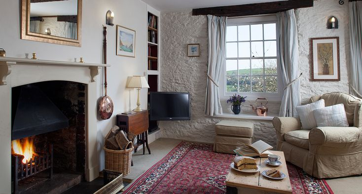 Beautiful period cottage for four near Looe with stunning views, log fire and private garden.