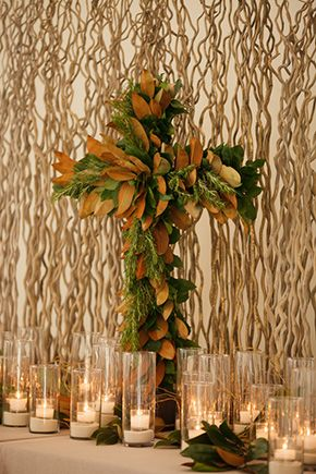 The altar was decorated with a magnolia leaf cross. // Photo By: http://candicekphotography.com