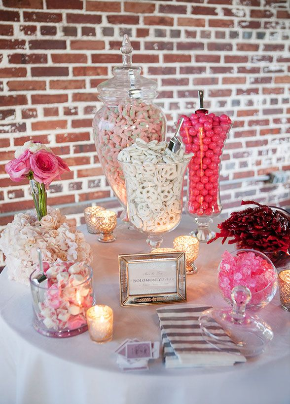 Candy stations are the sweetest trend in weddings right now and we're revealing everything you need to know to build the candy bar of your dreams. The key to creating a visually dynamic candy bar is highlighting your event colors throughout the display. Pink and gold wedding? Go for a variety of pin