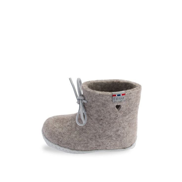 TOVA WOOL SLIPPER - MY FIRST SLIPPER - natural/brown. The Perfect Gift for Babies! 100% Merino wool with a genuine suede sole and white leather laces. This soft and comfortable style allows your baby's feet to move freely.  Wool's naturally insulating and breathable properties keep your baby's feet dry and warm.  Suede soles provide a natural anti-slip surface. Shoe box comes wrapped in a cotton bag.