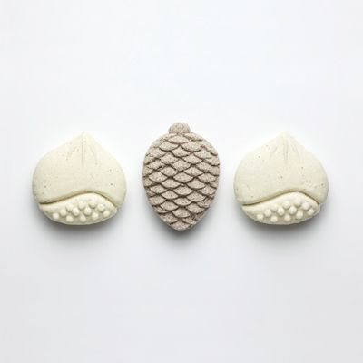 these could be made in wood | おひがし - pinecone and chestnut traditional sweets