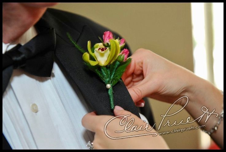 A stylish orchid and miniature rose boutonniere.