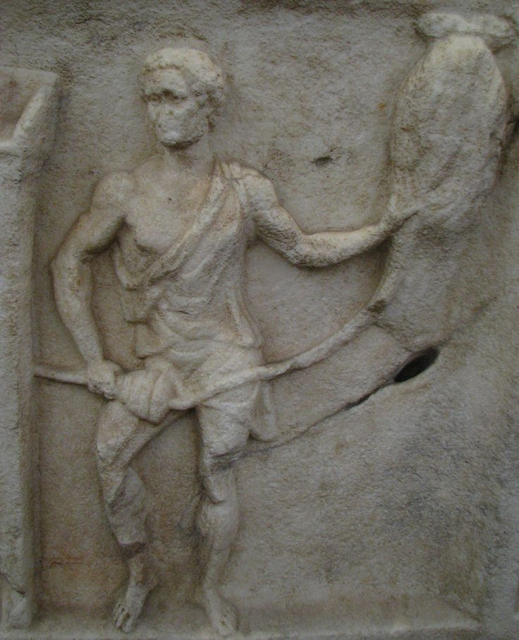 A Roman spinning flax from a distaff onto a spindle which he is rolling along his thigh, date unknown.