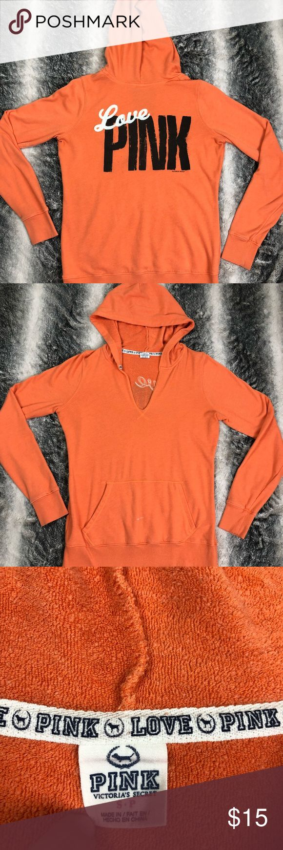Victoria's Secret PINK pullover sweatshirt PINK pullover orange women's sweatshirt  PINK logo on the back  Small bleach stain on pocket  Made out of polyester and cotton PINK Tops Sweatshirts & Hoodies
