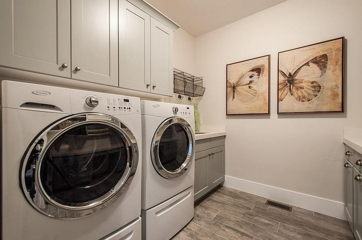 laundry rooms front load washer and shaker cabinets on
