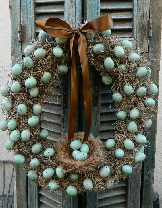 Spring Time Mossy Egg Wreath...this one is for sale, but you could do it at home. Buy a styrofoam or foam core wreath and hot glue the spanish moss to it...then glue on eggs from a craft store.  Add a birds nest and some ribbon and you have a beautiful spring wreath for your door!