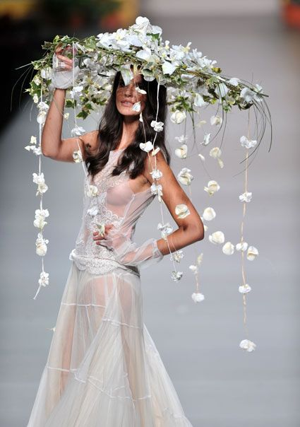 A model displays a hat made of flowers at Francis Montesinos's Madrid Fashion Week presentation.