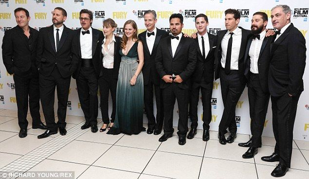 The team: (L-R) Jason Isaacs, director David Ayer, Brad Pitt, Anamaria Marinca, Alicia Von...