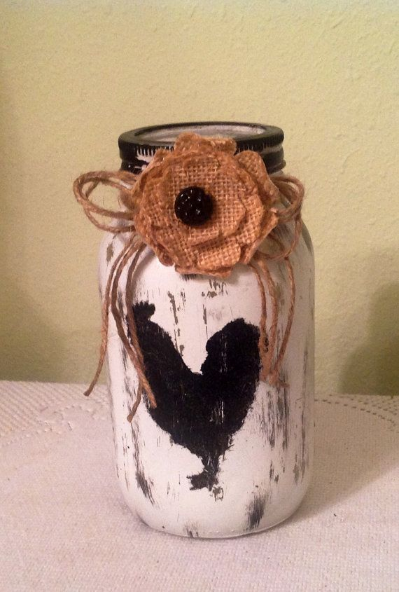 This quart size jar has been painted white, distressed and a cocky rooster painted in black added to the front. I painted the lid black, added jute bow and burlap flower. Please clean with damp cloth. Food safe. Flowers will vary depending on availability. Thanks for visiting and