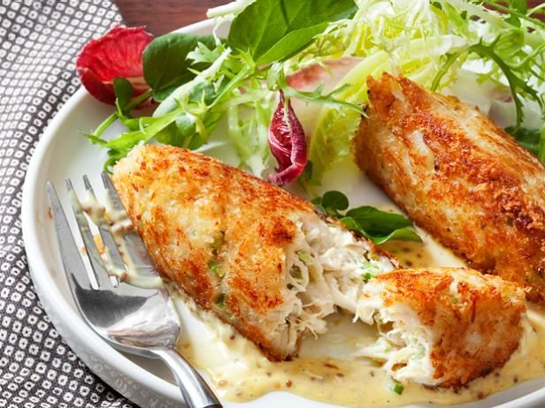 Prepare the crab cakes: Pulse the bread in a food processor to make coarse crumbs; spread out the crumbs on a sheet pan. In a large bowl, mix the crab, mayonnaise, egg yolk, celery and pickles. Form …