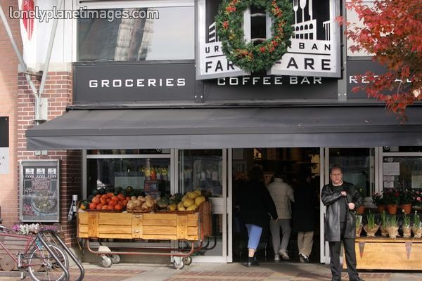 Man standing outside Urban Fare market, Yaletown. - Lonely Planet Images