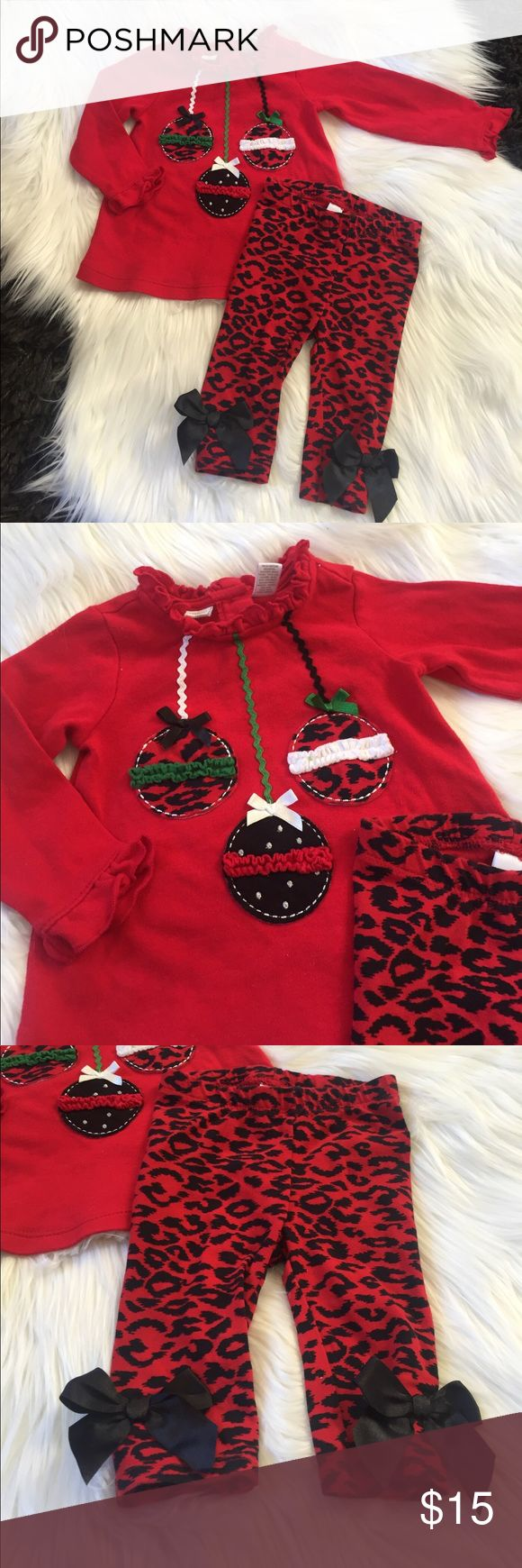 Infant Christmas Outfit First Impressions red long sleeve top with matching red and black animal print legging pants. The shirt has 3 hang ornaments and The pants have a black bow on each ankle. Like new condition, size 3-6 months First Impressions Matching Sets