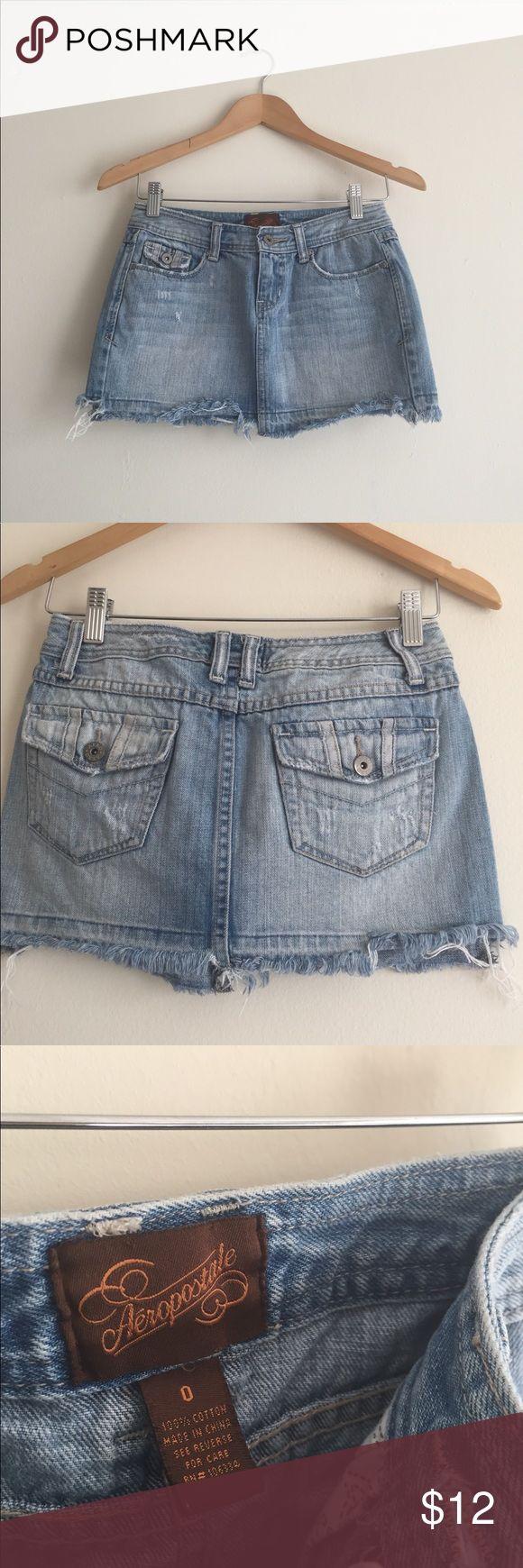 "Aeropostale distressed denim miniskirt, EUC Aeropostale distressed stonewash denim miniskirt, EUC, size 0. 11"" length, 26"" waist. Back pocket button & contrast stitch detailing, frayed hemline, 100% cotton. Aeropostale Skirts Mini"