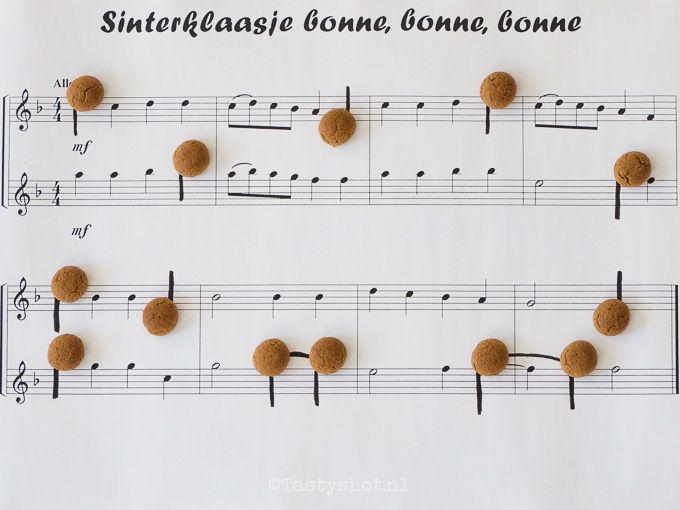 Pepernoten als muzieknoten op bladmuziek.