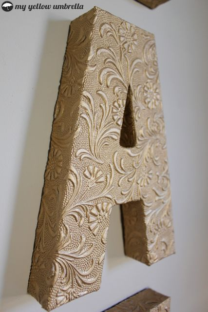 cardboard letter covered with textured scapbooking paper
