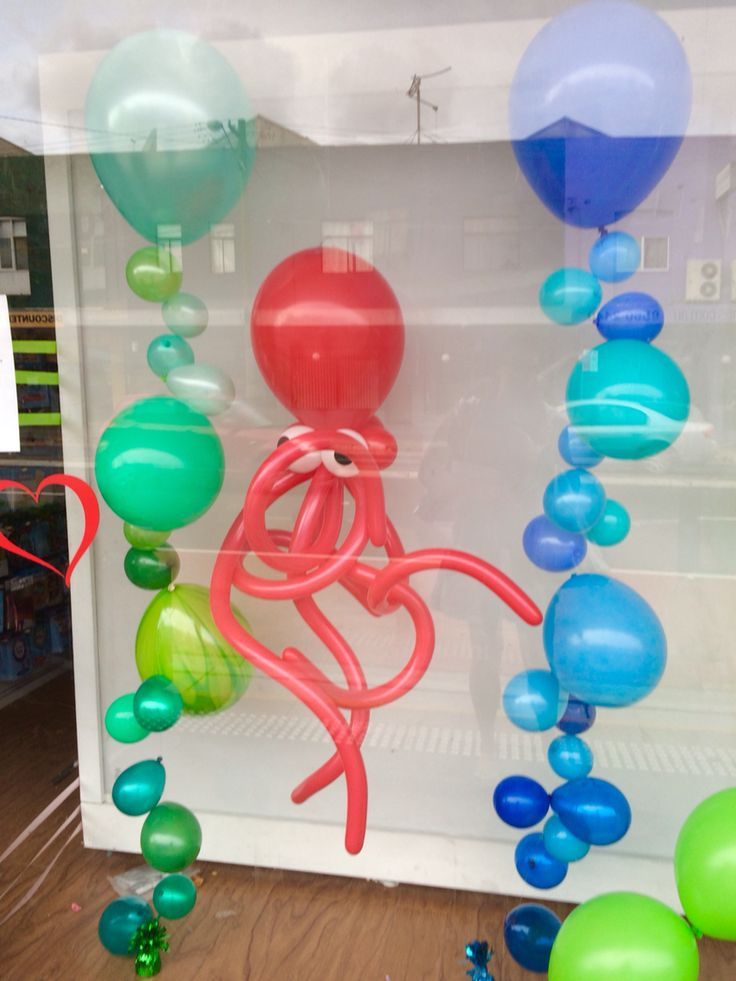 Gradient Bubble Strands in scales of blues and greens with our fun octopus creation for our window display #underthesea