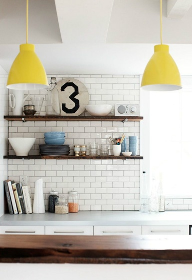 Whilst I'm not generally fond of open shelving for practical reasons (they tend to collect dust and grime), I think I could live with a couple of shelves where frequently used items would sit.  I also like the combo of the white brick pattern tiles and recycled timber shelving and small pops of colour coming from the pendant lights, plates and a jar of lentils provide just enough visual interest.