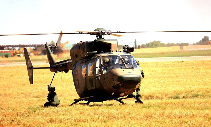 A stationary drop-off chopper being guarded by the passengers.