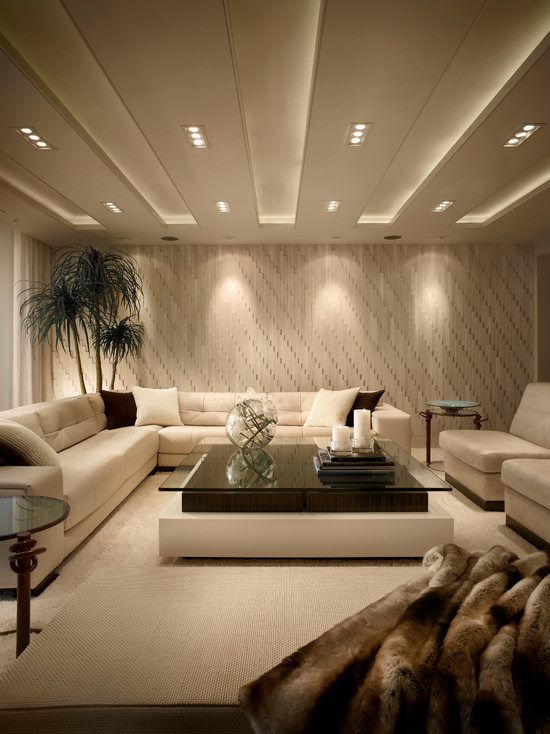 Cozy and classy basement with recessed lighting and lamps to make basement look like it has more light