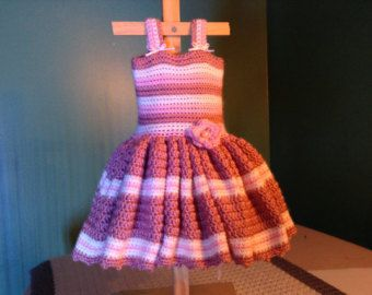 This lovely dress is made using a cable knit stitch - using crochet. It is for intermediate crocheters. This pattern has instructions for sizes 6mo - 3T. Have your little girl wear this dress with a long sleeve shirt underneath and she is all set for winter - the skirt is very warm and cozy. This is made with easy care, washable yarn.  This pattern goes along with my free YouTube tutorial. You can find it by searching for anna phelps crochet dress on YouTube.