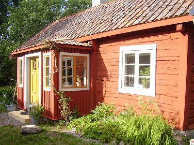 front of the cottage - painted with ochre light