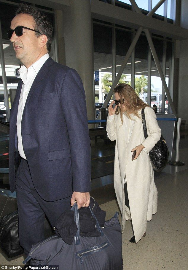 Elegant: Mary-Kate Olsen and her husband Olivier Sarkozy were spotted arriving to Los Ange...
