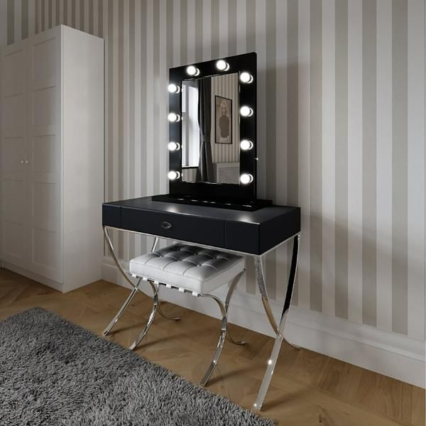 Hollywood Mirror In Black Gloss| Makeup Mirror with Lights | Dressing Table Mirror with Lights | Vanity Mirror with Lights | Illuminated Makeup Mirror | Holllywood Mirror UK | Light Up Makeup Mirror | Hollywood Mirrors | Mirror Size 80 X 60cm | This illuminated Hollywood mirror has 10 led light bulbs & an optional black high glossy stand for when used in the freestanding portrait position on your dressing table. #hollywoodmirror #makeupmirror #vanitymirror #dressingtable